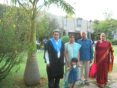 Appa, amma, Krithi, Jaagruthi and me, wearing the graduation robe