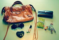 sunglasses leather bag keys mirror mac keychain ipod heart wallet purse crown foof mascara marcjacobs loreal applecore compact voodoodoll ralphlauren balenciaga besso lipglass cthru jonesnewyork videoipod voluminous motorcyclebag tintedlipglass