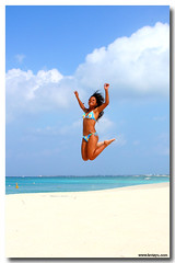 Beach Jump (Fevi in Pictures) Tags: pictures blue vacation sky white hot ariel beach islands jump sand day skies photos grand seven caribbean cayman yu mile governors rightplacerighttime fevi caymangirl