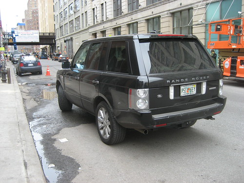 Range Rover parked 4 feet from the curb
