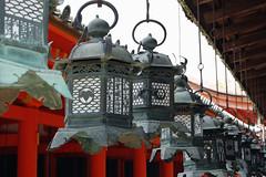 Kasuga Taisha: Hanging Lanterns (jpellgen) Tags: japan stone bronze japanese nikon shrine asia unesco lanterns  nippon lantern 1855mm nikkor nara kansai 2009 asuka jinja nihon taisha kasuga  fujiwara kinki honshu kasugayama  wakamiya d40  taishazukuri
