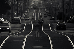 sunset rolls (razorbern) Tags: sanfrancisco california street sunset bw waves muni rails swells tramlines