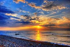 Dalla pace del mare lontano (valerius25) Tags: sardegna sunset sea beach d50 sand nikon tramonto mare sardinia ciao spiaggia hdr arbus sabbia banale portopalma valerius25 flumentorgiu tunaria valeriocaddeu