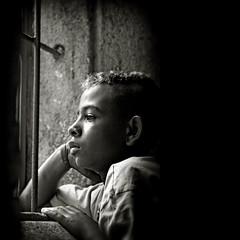 Leave darkness behind... (carf) Tags: poverty light boy brazil bw church window boys brasil sepia kids dark children hope blackwhite kid community support child risk darkness naturallight forsakenpeople chapel esperana social impoverished underprivileged afrobrazilian altruism development prevention itanhaem atrisk mundouno abigfave jonathan2 diamondclassphotographer