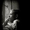 Leave darkness behind... (carf) Tags: poverty light boy brazil bw church window boys brasil sepia kids dark children hope blackwhite kid community support child risk darkness naturallight forsakenpeople chapel esperança social impoverished underprivileged afrobrazilian altruism development prevention itanhaem atrisk mundouno abigfave jonathan2 diamondclassphotographer