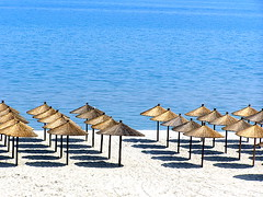 pure umbrellas in Greece (Dawid Wadysaw Cyprian) Tags: beach greece highfive neat amateurs supershot umbrelas abeauty abigfave amateurshighfive invitedphotosonly