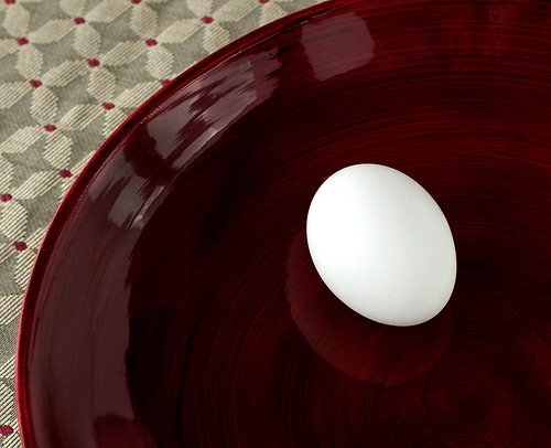 Red bowl, egg, still life