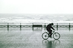 Stormy Hove (Stringendo) Tags: sea storm wet rain bike cycling cyclist hove 35faves twtmeblogged hp5plus40035mm ourworld2007