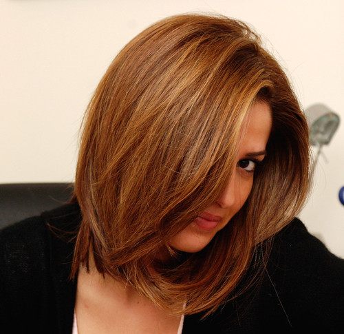 brunette hair with chunky highlights. Subtle dark blonde highlights