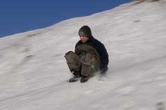 Sliding downhill on the bum