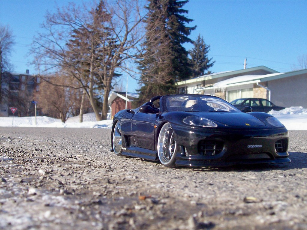 A Ferrari 360 Spider with deep dish wheels.