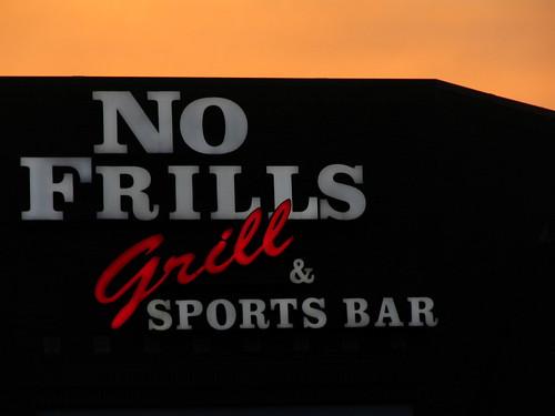 No Frills Grill & Sports Bar - A Sign
