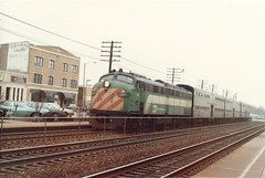 Burlington Northern commuter train approaching the La Grange Road commuter rail station. La Grange Illinois USA. Febuary 1985.
