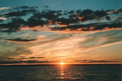Sunset on the beautiful Bay of Chaleur (TheProgrammerAnalyst) Tags: sunset canada bird water colors beautiful clouds golden bay flying bravo with newbrunswick puffy bertrand bathurst beresford berube chaleur naturesfinest blueribbonwinner nigadoo petitrocher 10favs bayofchaleur outstandingshots flickrsilver 25faves pointeverte shieldofexcellence colorphotoaward belledune superbmasterpiece bertrandberubeca diamondclassphotographer tornadoaward ultrashot thenaturegroup