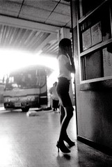 Bus Station (ej haas) Tags: people blackandwhite bw woman thailand cellphone communication transportation mobilephone chiangmai handphone arcadebusstation ejhaas2007