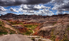 Badlands National Park, South Dakota (Thad Roan - Bridgepix) Tags: mountains color clouds southdakota landscape nationalpark scenery colorful shadows hills valley badlands hdr 200605 photomatix