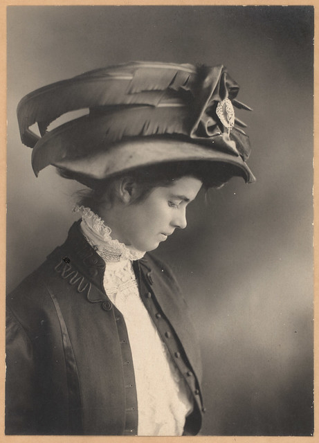 young victorian lady with a big fancy hat