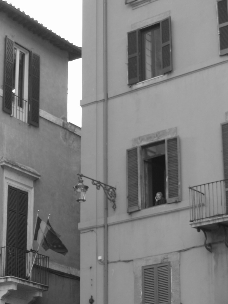 Little old lady watches the crowd below - Rome