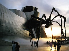Invasion at Bilbao (redcipolla) Tags: 2003 travel light sculpture spain bilbao frankgehry guggenheimmuseum commentsbest commentsicon abigfave takenbypartner