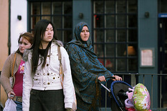 Three worlds together (Pawel Boguslawski) Tags: street people white wales canon three women muslim chinese cardiff hijab races 400d revolutionofrealwomen fds24h