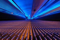 On The Floor (ChrisHepburn) Tags: longexposure blue manchester lights airport tunnel terminal walkway slowshutter nikonstunninggallery nikond40 superaplus aplusphoto diamondclassphotographer flickrdiamond nikkorafsdx1855f3556