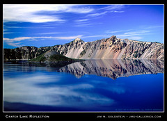 Crater Lake Reflection (jimgoldstein) Tags: blue sky cloud white mountain reflection nature water wall oregon landscape grey volcano photo bravo fuji gray cyan slide slidefilm velvia crater caldera craterlake geology top20landscape rim wizardisland freshwater craterlakenationalpark splendiferous outstandingshots specland jmggalleries anawesomeshot colorphotoaward impressedbeauty jimmgoldstein superbmasterpiece diamondclassphotographer flickrdiamond top20blue superhearts
