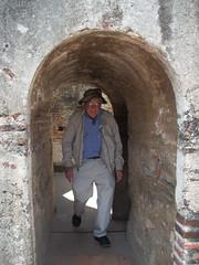 Gilbert negotiating a narrow entrance in Las Capuchinas convent, Antigua, Guatemala, Photo by Char (ali eminov) Tags: guatemala antigua gilbert centralamerica convents monasteries lascapuchinasconvent