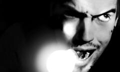 evil when the lights go out... (urline) Tags: light shadow portrait blackandwhite bw selfportrait me face bulb self dark licht gesicht darkness bad evil ampoule bse electricity sw schwarzwei wei eos350d schatten strom schwarz dunkel glhbirne dunkelheit elektrik glhlampe urline superaplus aplusphoto