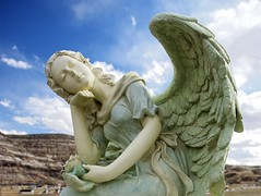 Angel of the Morning (Floating Imitations) Tags: blue sky sunlight cemetery statue angel clouds drumheller abigfave diamondclassphotographer flickrdiamond searchandreward calgaryflickrmeetapril07roadtrip