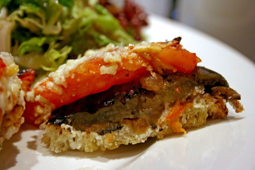 Innards of Grilled Eggplant and Tomato Tartine, Goat Cheese, and Black Olive Tapenade