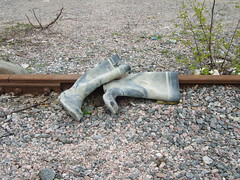 Rubber boots (dumell) Tags: old dusty suomi finland spring helsinki rust iron europe track boots stones pair tracks rail railway ground dirt helsingfors dust railwaytrack rubberboots gravel vallila