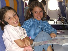 Anna and Caleb on the flight to Bangkok