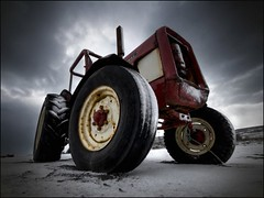International tractor ... (asmundur) Tags: red snow tractor cold truck iceland bravo menacing freezing tire shining hdr pf ominoussky singleexposure 1xp groundlevelview february2007 canonefs10223545usm bratanesque