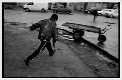Run Away (Levan Kakabadze) Tags: street bw film 35mm georgia kid nikon gun peace kodak streetphotography documentary run nikonfm10 onelove toygun batumi tabu adjara allrightsreserved   ajaria heshotmewithit ubrankid levankakabadze