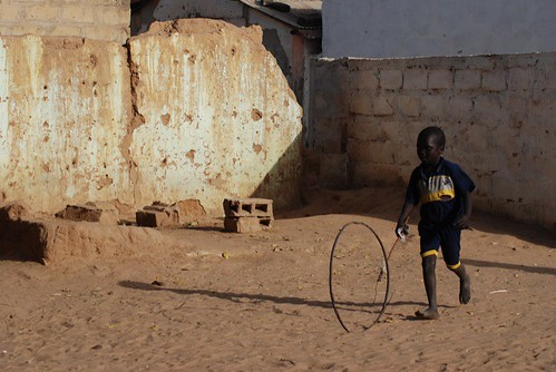 Boy chasing a wheel