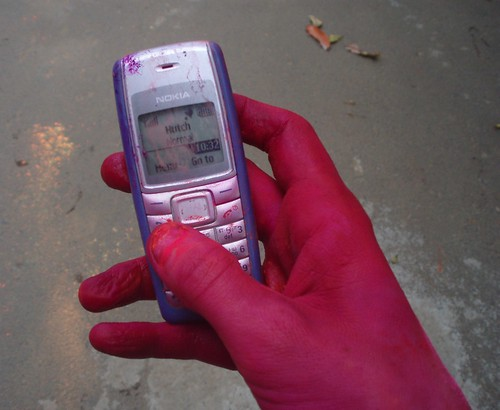 Using my phone during holi festival