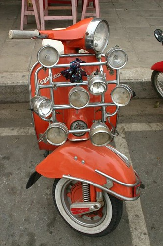 Vespa with head lights...