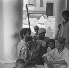 Allan Fakeer as a Young Performer (Daudpota) Tags: pakistan musician music saint photography poetry cemetary bodylanguage graves poet performer sufi sindh mystic developingcountry southasia isadaudpota shahlateef bhitshah
