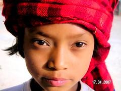 intense gaze (kristineinindonesia) Tags: travel portrait people girl intense asia southeastasia serious expression burma myanmar gaze burmese blueribbonwinner