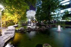 The calm before the day (.craig) Tags: trees light england building tree london water fountain architecture photography lights rocks path stones photographic craig docklands lamps 50v5f craigallen anabadili