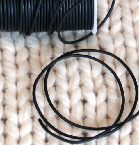 Black leather cord on Rowan Big Wool