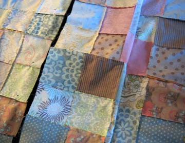 Panels of the quilt being sewn together