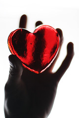 happy flickrversary, to me. (solecism) Tags: red glass silhouette hand heart touch flickrversary hold