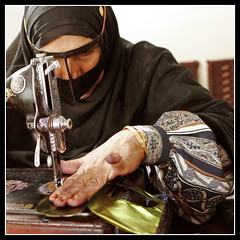 Iranian Bandari Woman (Roozbeh Feiz) Tags: winter people woman eye face scarf canon asian persian eyes hands women asia village hand dress faces iran body canon20d muslim islam middleeast culture photojournalism documentary persia social instant iranian moment gesture impromptu  cultures cultural islamic burqa socialdocumentary 2007 spontaneous gestures instantphotography villagelife 1385   roozbeh hormozgan feiz  iranianwomen spontaneousphotography handheldphotography abigfave roozbehfeiz nosetup iraniandresses persiandresses withoutsetupphotography nosetupphotography iranianstyle persianstyle ~vista iranianphotographer iranianphotographers   feizaghaii      hormozganprovince