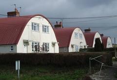Modernism in Camelot (Fray Bentos) Tags: england hill somerset housing howell a303 nissenhut modernisthouse arthurianlegend westcamel howellhill