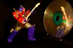 Rockgod practice (revlimit) Tags: toys prime guitar transformers nikkor guitarhero ais optimusprime rockgod manuallens revoltech awesomesauce nikond40 nikkor55mm28micro 55mm28macro