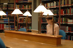 LibraryKC028_lowres (Jisc) Tags: female table student laptop library lamps bookshelves studying kingscollegelondon stripytop