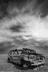 Damaged by nature - bw (A.alFoudry) Tags: sky bw white storm black car clouds canon 5d kuwait wrecked q8 abdullah 1740l    kuw  xnuzha alfoudry  abdullahalfoudry foudryphotocom  kuwaitvoluntaryworkcenter