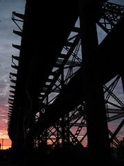 Brace yourself (nathansnider) Tags: railroad bridge sunset sky silhouette clouds tracks transportation infrastructure saintlouis pillars stl beams bracing
