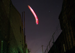 blimp cruising over Fitzroy (_barb_) Tags: sky night alley fitzroy zeppelin australia melbourne blimp lightstreak melbflickrapril2007